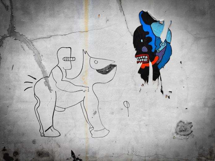 Teken aan de wand #62 Masker. Tienen, Broekstraat, 29 november 2015, Foto Hendrik Elie Vanden Abeele. Te Voet in de Stad